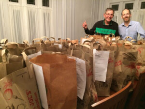 Carl and Jon with donated bags of food